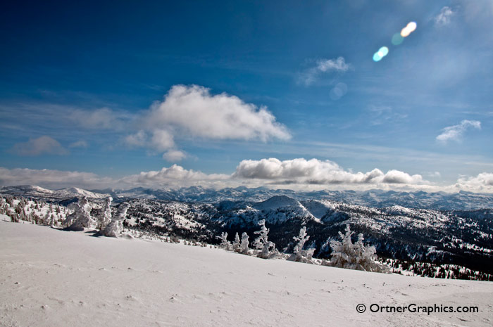 Photo of blue sky and mountains with a snowcovered foreground