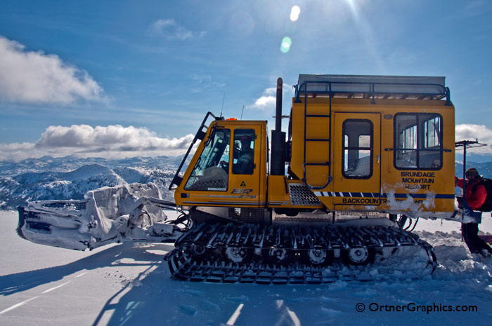 Photo of a man unloading a snowcat