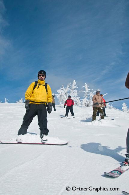 photo of Snowboarders and skiers waiting for their run