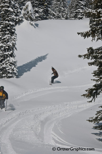Photo of a Snowboarder Laying Fresh Tracks