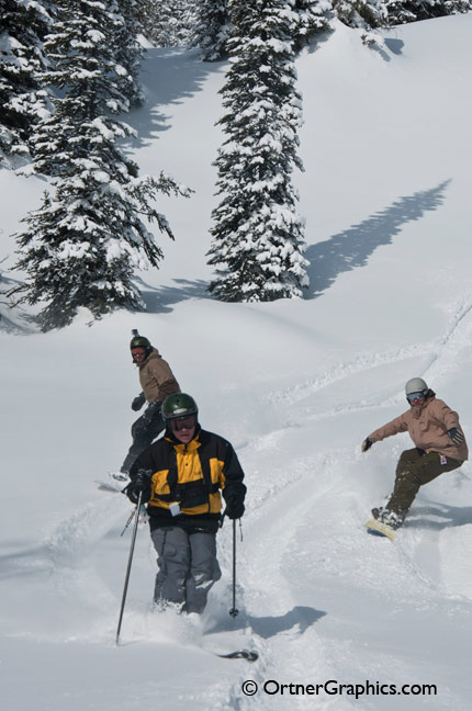 Photo of Snowboarders and Skiers