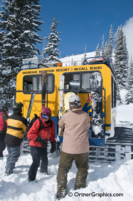 Photo of Skiers and Snowboarders Putting their Gear on the back of a Snowcat