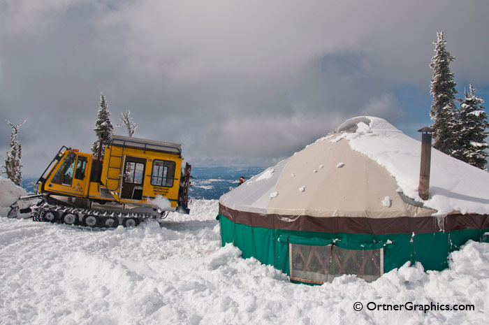 Photo of a Snowcat and Yurt on Mountain Top