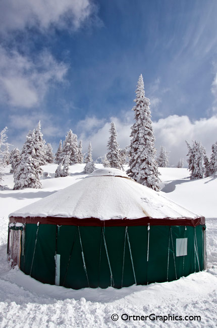Photo of a Yurt covered in Snow